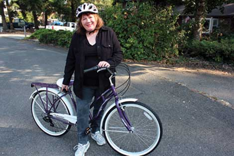Barbara Sellers won a women's bicycle for $18.95 in bids on a penny auction site. (Ryan K. Harvey/courtesy photo)