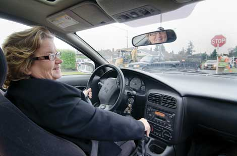 """Juli McGruder, a professor emerita at University of Puget Sound, sat at the wheel of a """"fitted"""" car during the school's CarFit event in 2011. (Courtesy photo)"""