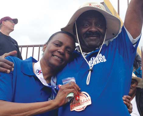Madonna Hanna celebrates at the National Senior Games with her husband and coach, J. Steven Hanna.