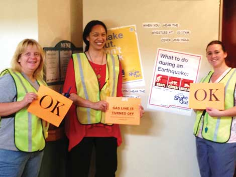 Staff members Leslie Jo Thompson, Maringi Lloyd and Amanda Boysen, members of the safety committee at Bridgeport Place, helped organize an earthquake drill for the Great Shakeout event. (Courtesy photo)