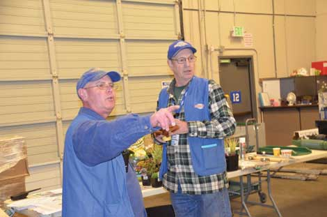 Joe Freeman and Ron Linck of the McLendon Hardware store in Tacoma addressed customers at a recent workshop on rain gardens and water retention for homeowners. (Joan Cronk/Senior Scene)
