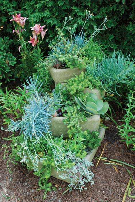 Stacked troughs are an example creative uses of containers for backyard gardening.