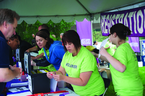 Volunteers helped participants get ready for the two-mile Walk to End Alzheimer's in Tacoma last year. The Alzheimer's Association will host the event again Sept. 13 in Tacoma, as well as another walk the next day in Bremerton.