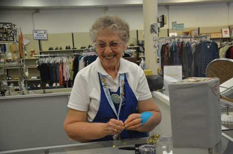 Pat Tribby enjoys volunteering at Grannies' Attic. One of her jobs is to price items before they go out on the thrift store's floor for sale. (Joan Cronk/Senior Scene)