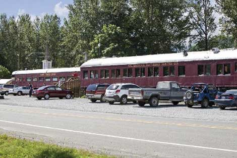 Motorists on their way to Mount Rainier can stop at railroad cars next to the highway in Elbe for dining at the Mount Rainier Railroad Dining Company.
