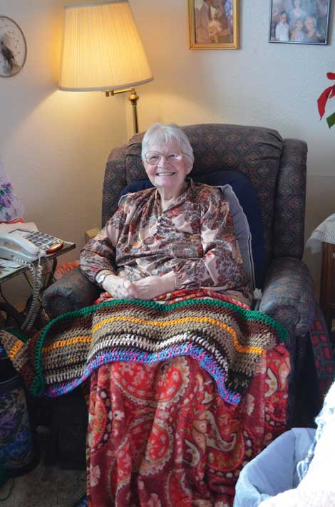 At her home in Sumner, Betty Murray makes scarves by hand for people at a Tacoma homeless shelter. She can always use donations of yarn. (Joan Cronk/Senior Scene)