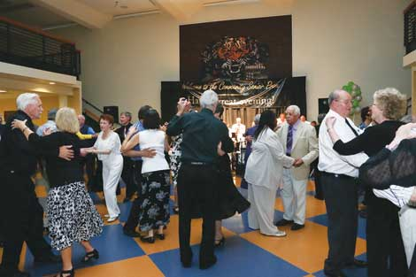 Couples take a turn on the dance floor during last year's Senior Prom. This year's prom for folks 55 and older will be held May 30 at Clover Park Technical College in Lakewood.