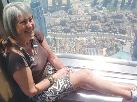 Linda Finch at the top of Burj Khalifa, the tallest building in the world, in Dubai.