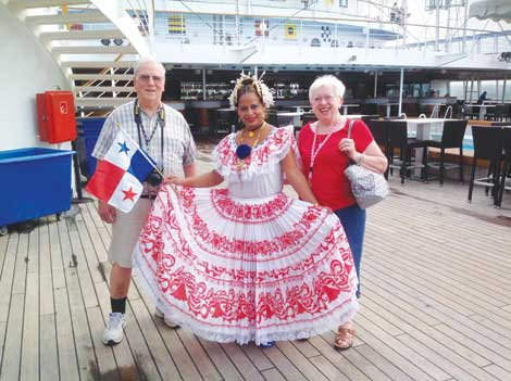Pete and Rose Neff joined a Panamian dancer on deck as the Norwegian Sun passes through the Panama Canal.