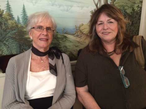 Joan Olson (left), a member of the Retired Senior Volunteer Program, and Candy Johnson, who participates in the Senior Companion program, received the Governor's Volunteer Award during a ceremony in Olympia.