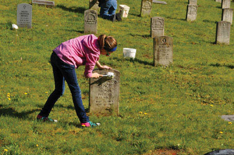 Volunteers are making an annual habit of scrubbing headstones at graves of veterans at Washington Soldiers Home in Orting. (Courtesy photo)