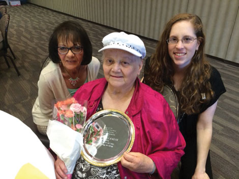 Pat Sparrow, holding her Silver Plate award from Kitsap Meals on Wheels, with Donna Jones (left) of Catholic Community Services and Julie Kerrigan of Lutheran Community Services Northwest.