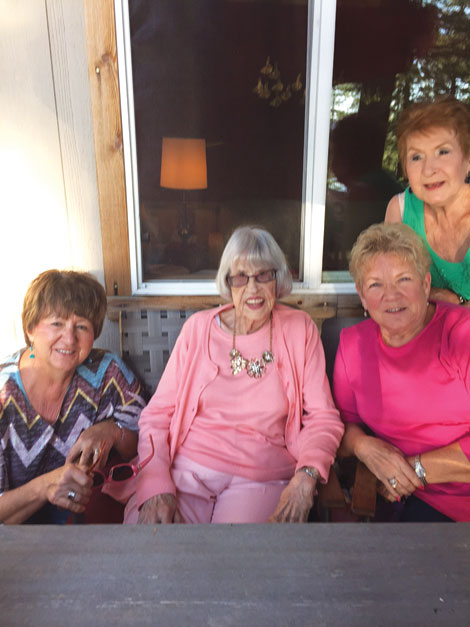 Audrey Stacy (second from left) celebrates her 100th birthday with Gail Kincaid, Jackie Sue Wilkins and Wesley Ann Schulhauser.