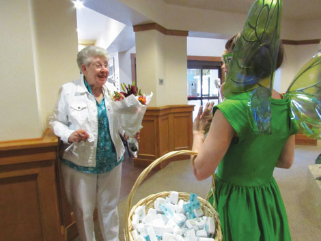 Delta Dental of Washington's mascot, the Tooth Fairy, surprised residents at the Quail Park senior community in Lynnwood with flowers, dental floss and tooth brushes as a reminder of good oral health.