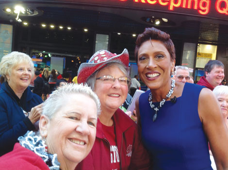 """Tour group members Mary Jean King and Jeanette Harris posed outside the """"Good Miorning America"""" television show studio in New York City with host Robin Roberts."""