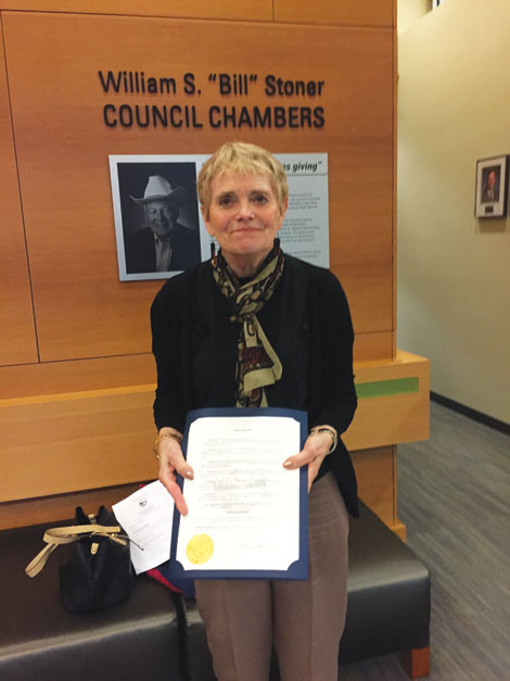 Linda Henry, president of the board of Puyallup Area Aging in Community Committee, accepted a City of Puyallup proclamation declaring the third week of October as Aging in Place Week.  Joan Cronk/for Senior Scene)