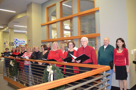 The Tapestry Singers get ready to perform holiday songs at the Puyallup Public Library. (Joan Cronk/for Senior S)cene