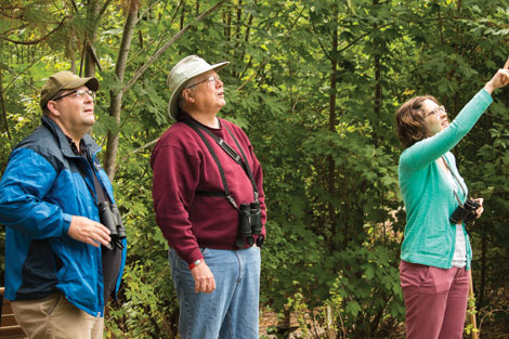 Russ Smith (middle) is a volunteer guide for birdwatching walks sponsored by Tahoma Audubon. (Emily Matthiessen/courtesy photo)