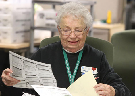 One of the 450 temporary election workers in Pierce County who helped sort mailed-in ballots at the county elections center. (Jim Bryant/for Senior Scene)
