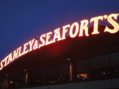 The iconic lighted sign of Stanley & Seafort's beckons diners like a beacon from a hill overlooking Tacoma.