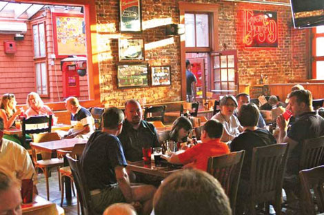 Brick walls and wood floors add warmth and charm to the dining environment of Engine House Number 9.