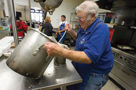 John Budzak, a Puyallup Lions club member for 40 years, prepared some pancake batter for the monthly seniors breakfast Dec. 10 at Puyallup Activity Center. (Jim Bryant/for Senior Scene)
